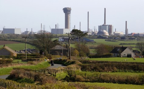 Image: A man walks along a road near the Sellafield nuclear reprocessing site in Cumbria, England.