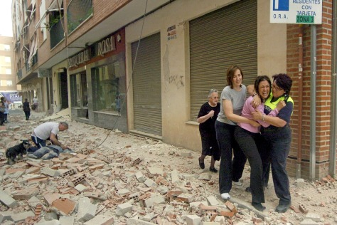 Image: Victims of quake in Lorca, southern Spain