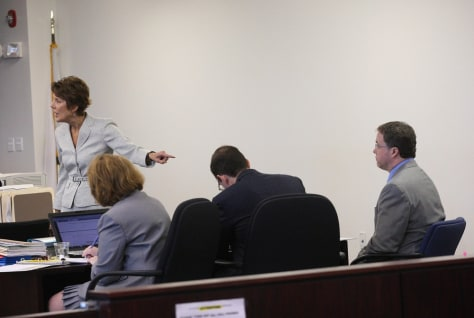 Image: Prosecutor Elizabeth Keeley, and Mark Kerrigan, right
