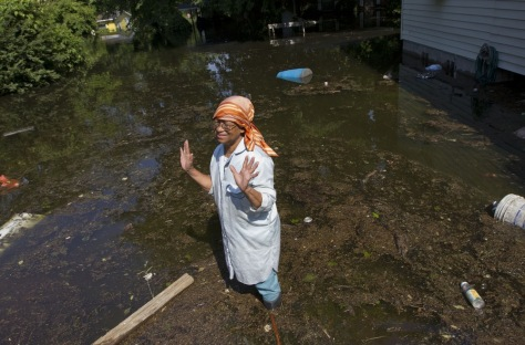 Image: Woman outside flooded home