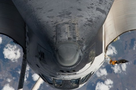 The nose, the forward underside and crew cabin of the space shuttle Endeavour approach first as the STS-134 vehicle prepares to dock with the International Space Station on May 18, 2011 (Flight Day 3). An Expedition 27 crew member took this photo at a distance of about 600 feet (180 meters).