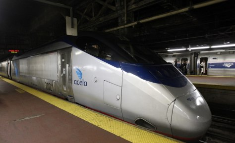 Image: An Acela train sits on the platform at New York's Penn Station