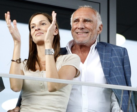 "Image: Dietrich Mateschitz and an unidentified woman watch the opening of the ""Red Bull Ring"" motorsport race circuit in Spielberg"