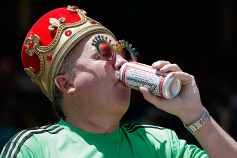 Image: Joe O'Dea drinks a beer before the 136th running of the Preakness Stakes at Pimlico Race Course