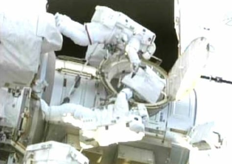 Image: Space shuttle Endeavour astronauts Drew Feustel and Mike Fincke exit the Qwest airlock at the beginning of their spacewalk in this image by NASA TV