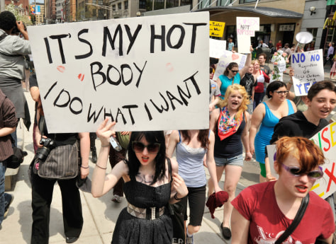 "Image: Women march through downtown Boston during the ""SlutWalk"" in Boston, Mass"