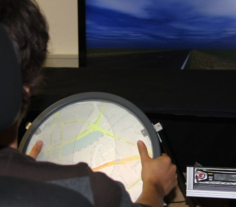 Image: A touch-screen steering wheel prototype that lets drivers control settings with their thumbs.