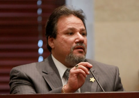 Image: Geraldo Bloise, an investigator with the Orange County, Fla., Sheriff's Department