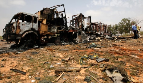 Image: A truck, damaged by coalition air strikes last night according to the Libyan government, is seen in Tripoli
