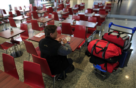 Image: traveler in airport restaurant