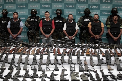 Image: The Mexican Navy lines up suspected members of the Zetas drug gang