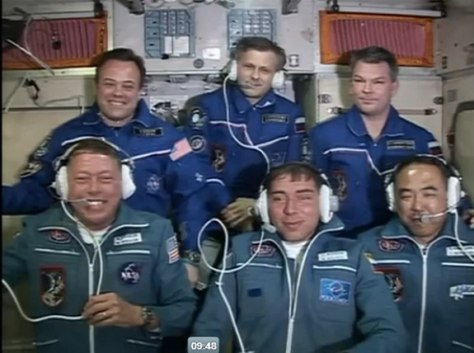 Screenshot: six astronauts on space station