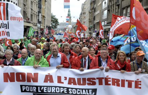 Image: Members of the European Trade Union Federation demonstrate in Luxembourg