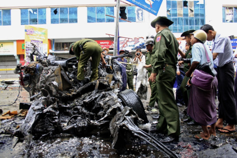 Image: Myanmar police inspect the site of a blast in Mandalay