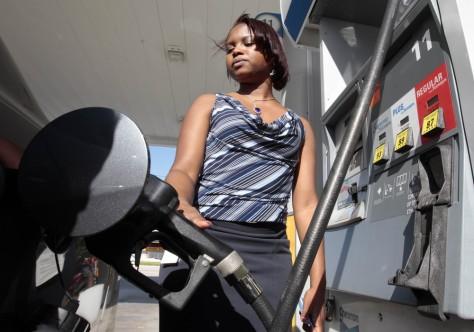 Image: Carmel Cine fills her car's tank