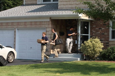 Image: Authorities remove packages from a house in Merrick, N.Y.