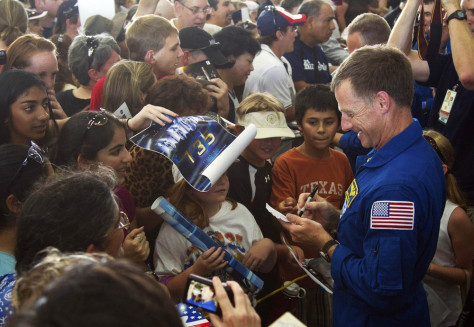 Image: Space shuttle Atlantis Chris Ferguson signs autographs following a welcome home ceremony for the last shuttle crew.