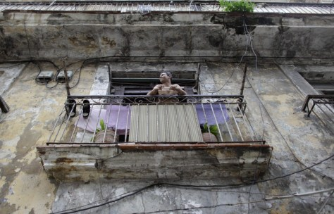 Image: A man on his balcony in Cuba