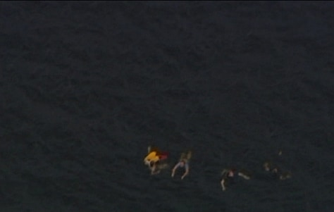 Image: An aerial view shows people swimming in the water close to Utoya island after the shooting