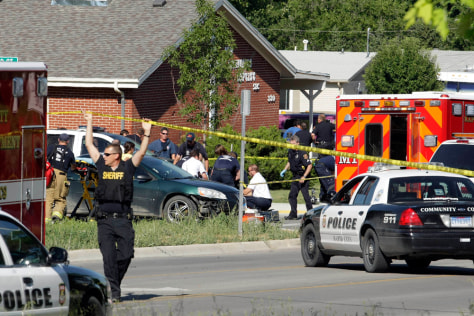 Image: Rapid City Firefighter/Paramedics and Rapid City Police Department personnel respond to shootings at the intersection of Anamosa and Greenbriar streets, in Rapid City, S.D.