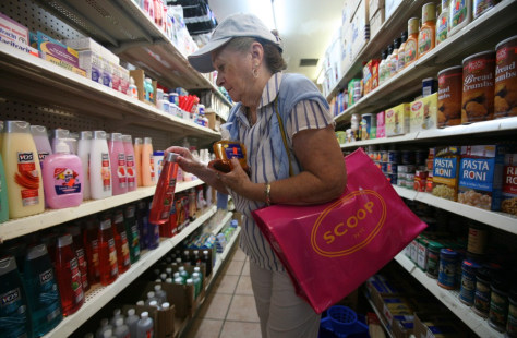 Image: A woman shops at a dollar store