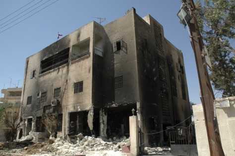 Image: A damaged police station is seen in Hama, Syria