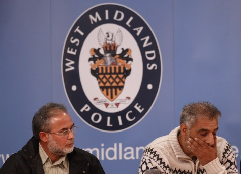 Image: Tariq Jahan, right, the father of Haroon Jahan, and Abdullah Khan, the uncle of brothers Shazad Ali and Abdul Musavir, speak during a news conference saturday in Birmingham, England