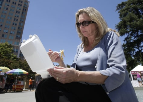 Image: D'Anne Ousley has lunch out of a plastic foam container