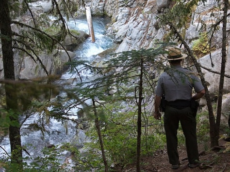 Image: Ranger at site of falls where visitor died