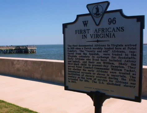 Image: A sign explains Fort Monroe's history as the landing spot for the first Africans to arrive in what would become America, in Chesapeake, Virginia