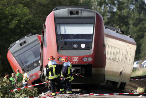 Image: Firefighters stand in front of a derailed train in Bad Lausick near Leipzig, eastern Germany,