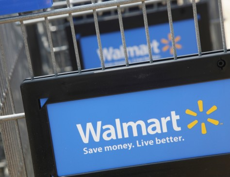 Image: File photograph of shopping carts seen outside a new Walmart Express store in Chicago