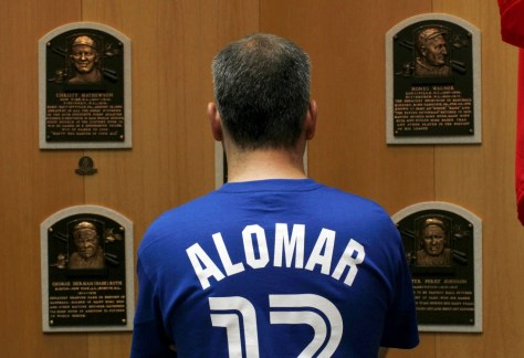 Image: A Toronto Blue Jays fan wears the Blue Jays shirt of former Major League Baseball (MLB) star Roberto Alomar as he views the plaques of baseball legends inside the National Baseball Hall of Fame in Cooperstown, New York