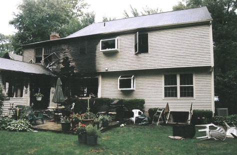Image: Fire-damaged portion of the Petit family home