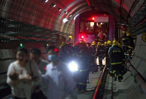 Image: Rescuers evacuate subway passengers in Shanghai