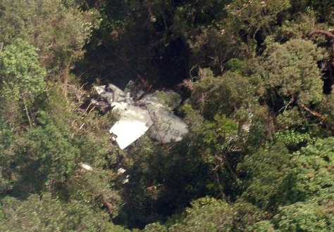 Image: A CASA 212-200 aircraft rests on trees in an isolated jungle area near Langkat district, North Sumatra, Indonesia, where 18 aboard were found dead on Saturday.