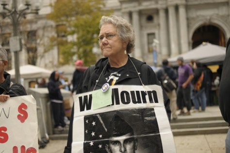 Image: Celeste Zappala of Philadelphia takes part in the Occupy Philadelphia protest outside of City Hall