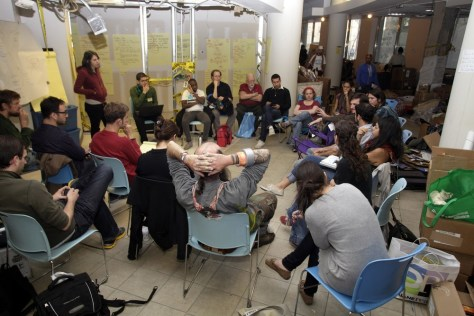 Image: A group of activists hold a strategy meeting