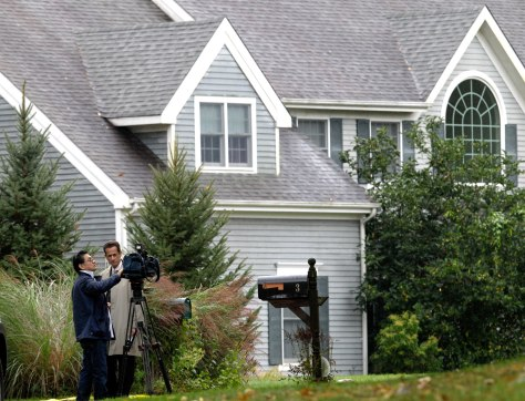 Image: Journalists prepare their report in front of the home of Sam and Amy Friedlander
