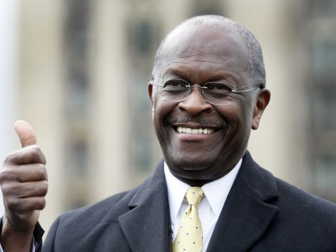 "Image: Republican Presidential candidate Herman Cain gestures to the crowd during a campaign stop to launch his ""Economic opportunity zone plan"" in front of the empty, closed Michigan Central Train Station in Detroit,"