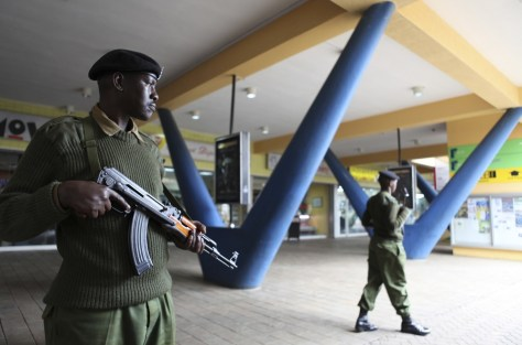 Image: An administration policeman keeps guard outside a shopping mall in the suburbs of capital Nairobi