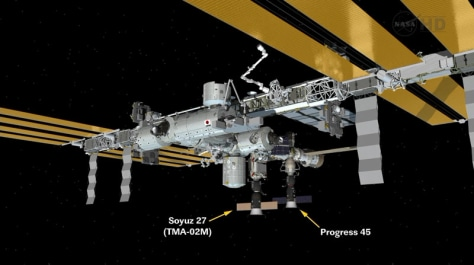 Graphic shows Progress 45 unmanned cargo ship after docking