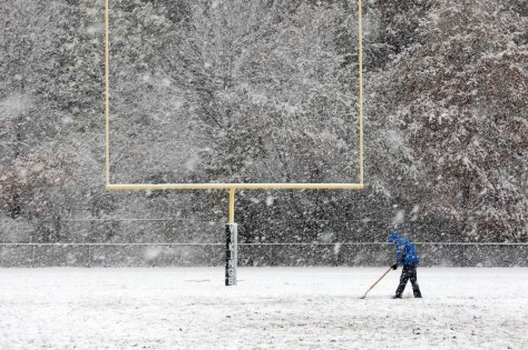 Image: Snow on high school football field