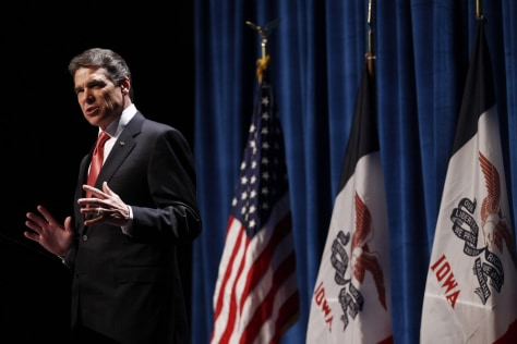 Image: U.S. Republican presidential candidate and Governor of Texas Rick Perry speaks at the annual Republican Party of Iowa Ronald Reagan Dinner in Des Moines, Iowa
