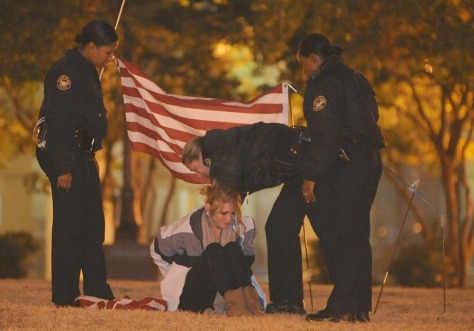 Image: A lone member of the Occupy Atlanta movement is arrested in Woodruff Park early on Monday.
