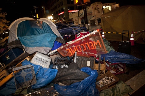 Image: Trash is piled high near Zuccotti Park, Occupy Wall Street's longtime encampment in New York, during the cleanup effort early Tuesday.