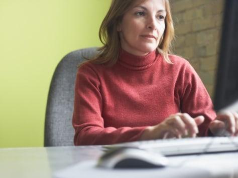 Image: Woman at computer