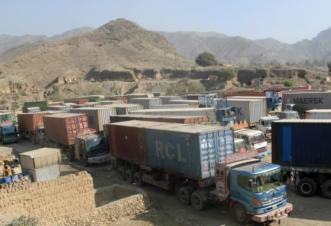 Image: Trucks carrying supplies for NATO forces in Afghanistan parked at Pakistan's Torkham border crossing