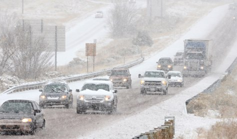Image: Vehicles on snowy I-25 near Santa Fe, N.M.
