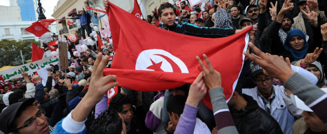 Image: Tunisians turn out to demand jobs and dignity as the country marks a year to the day since its despotic ruler fled